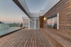 Penthouses by the sea with decking boards and cladding boards in bamboo
