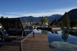 Bamboo decking board around a swimming pool and a lake