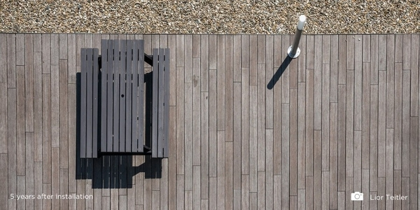 How do bamboo decking and cladding boards change colour?